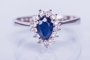 Inel din argint cu safir albastru si topaz alb